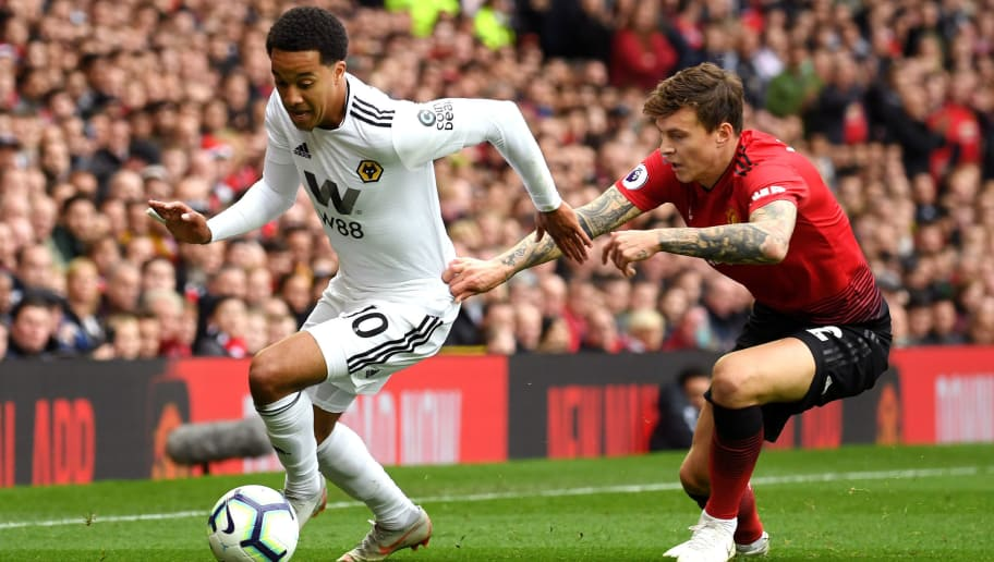 MANCHESTER, ENGLAND - SEPTEMBER 22:  Helder Costa of Wolverhampton Wanderers is challenged by Victor Lindelof of Manchester United during the Premier League match between Manchester United and Wolverhampton Wanderers at Old Trafford on September 22, 2018 in Manchester, United Kingdom.  (Photo by Ross Kinnaird/Getty Images)