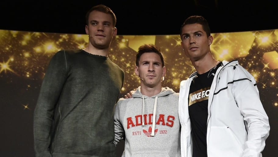(From L) Bayern Munich and Germany goalkeeper  Manuel Neuer, Barcelona and Argentina forward Lionel Messi and Real Madrid and Portugal forward Cristiano Ronaldo pose durring a press conference ahead of the  2014 FIFA Ballon d'Or award ceremony at the Kongresshaus in Zurich on January 12, 2015.   AFP PHOTO / FABRICE COFFRINI        (Photo credit should read FABRICE COFFRINI/AFP/Getty Images)