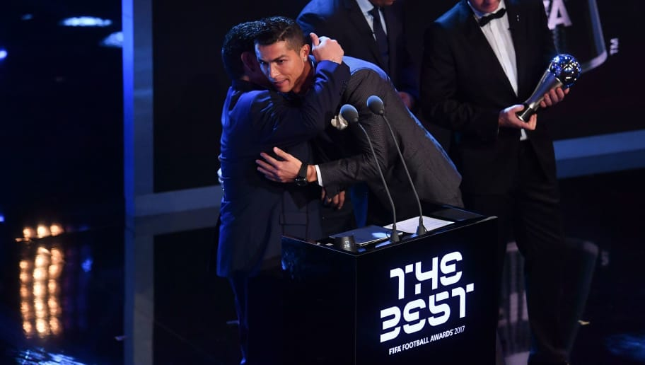 Real Madrid and Portugal forward Cristiano Ronaldo (2nd L) embraces Argentina's former player Diego Maradona (L) as he wins The Best FIFA Men's Player of 2017 Award during The Best FIFA Football Awards ceremony, on October 23, 2017 in London. / AFP PHOTO / Ben STANSALL        (Photo credit should read BEN STANSALL/AFP/Getty Images)