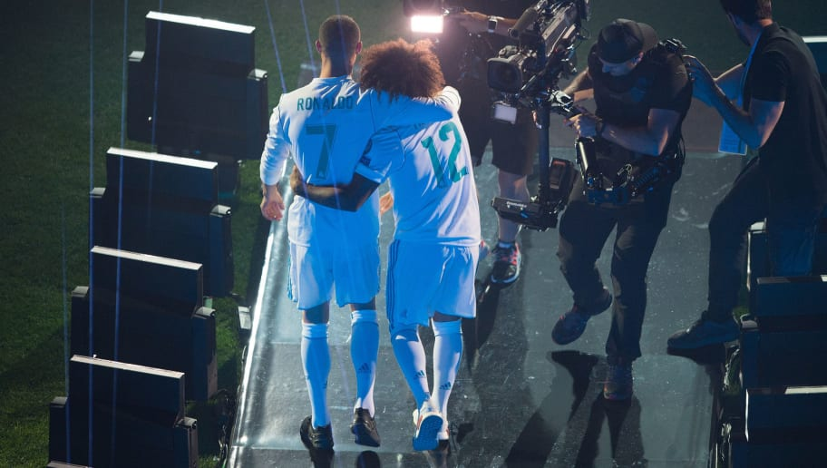 MADRID, SPAIN - MAY 27: Cristiano Ronaldo and Marcelo of Real Madrid celebrate at the Santiago Bernabeu stadium following their victory last night in Kiev in the UEFA Champions League final, on May 27, 2018 in Madrid, Spain. Real beat Liverpool 3-1 in the final to lift the European Cup and Champions League for the 13th time. (Photo by Denis Doyle/Getty Images) (Photo by Denis Doyle/Getty Images)