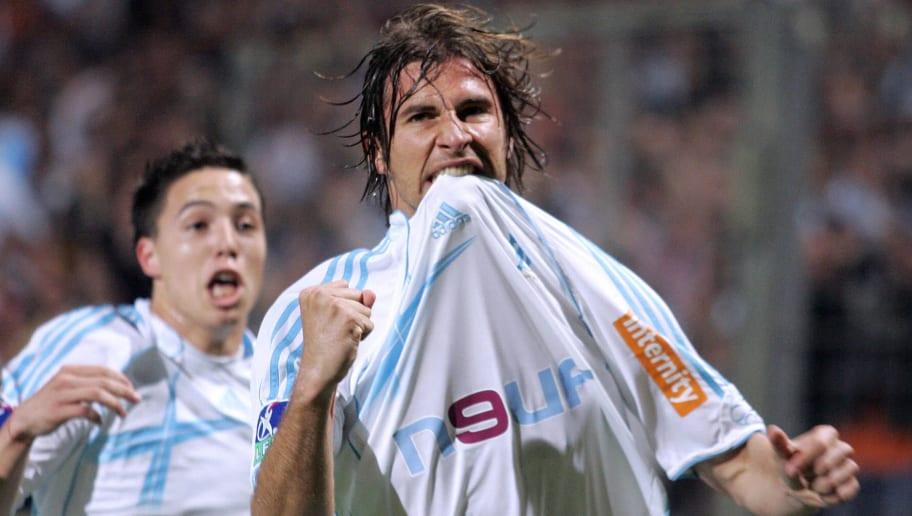 Marseille defender Lorik Cana celebrates...