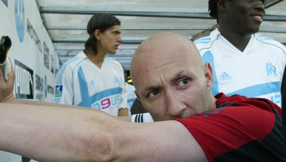 Bordeaux, FRANCE:  Marseille's goalkeeper Fabien Barthez warms up before the French L1 football match opposing Bordeaux to Marseille, 13 May 2006 at Chaban-Delmas stadium in Bordeaux. Barthez plays his last game for Marseille in the closing French league game at Bordeaux. The 77-times capped player who moved to the Cote d'Azur side from Manchester United in January 2004, cited family reasons for his decision not to take up the offer of a new contract.  AFP PHOTO MICHEL GANGNE  (Photo credit should read MICHEL GANGNE/AFP/Getty Images)