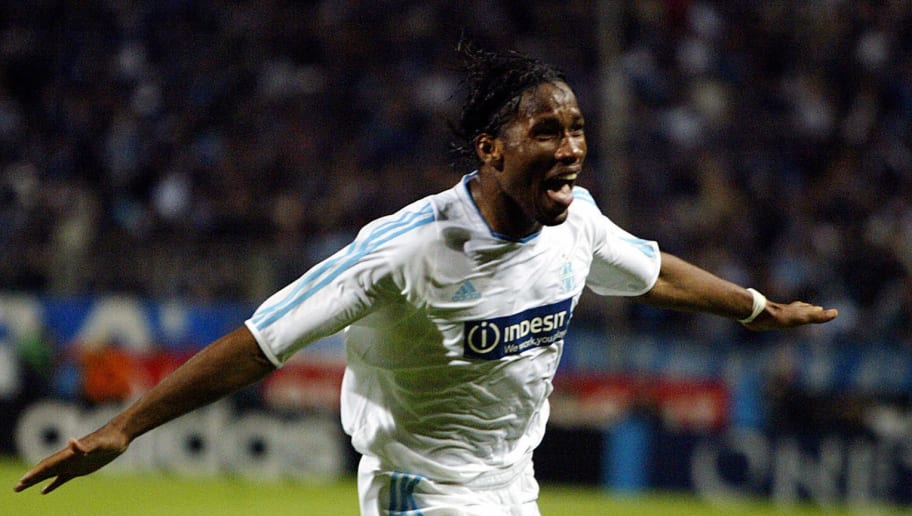 MARSEILLE, France:  Marseille's Ivorian forward Didier Drogba jubilates after scoring the second goal during the UEFA Cup semi-final second leg football match against Newcastle, 06 May 2004 at the Velodrome stadium in Marseille.  AFP PHOTO GERARD JULIEN  (Photo credit should read GERARD JULIEN/AFP/Getty Images)