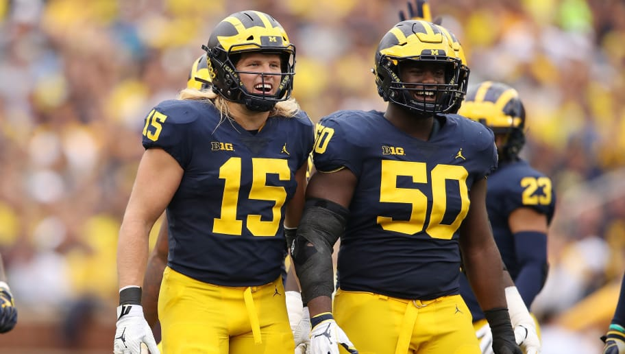 ANN ARBOR, MI - OCTOBER 06:  Chase Winovich #15 of the Michigan Wolverines and Michael Dwumfour #50 look on while playing the Maryland Terrapins on October 6, 2018 at Michigan Stadium in Ann Arbor, Michigan. Michigan won the game 42-12. (Photo by Gregory Shamus/Getty Images)