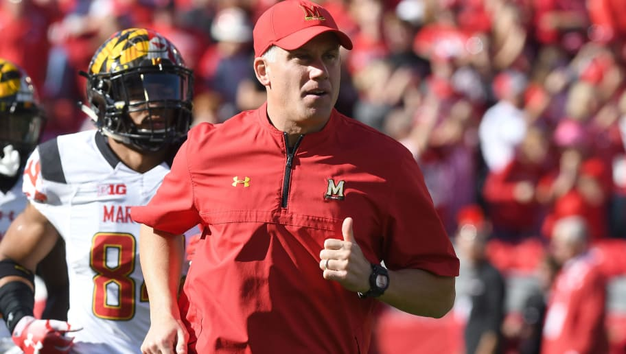 MADISON, WI - OCTOBER 21:  Head Coach DJ Durkin of the Maryland Terrapins runs onto the field before the game against the Wisconsin Badgers at Camp Randall Stadium on October 21, 2017 in Madison, Wisconsin.  (Photo by G Fiume/Maryland Terrapins/Getty Images)