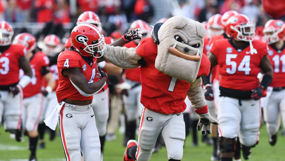 ATHENS, GA - NOVEMBER 17: Mecole Hardman #4 of the Georgia Bulldogs takes the field with team mascot Hairy Dog before the game against the Massachusetts Minutemen on November 17, 2018 at Sanford Stadium in Athens, Georgia. (Photo by Scott Cunningham/Getty Images)