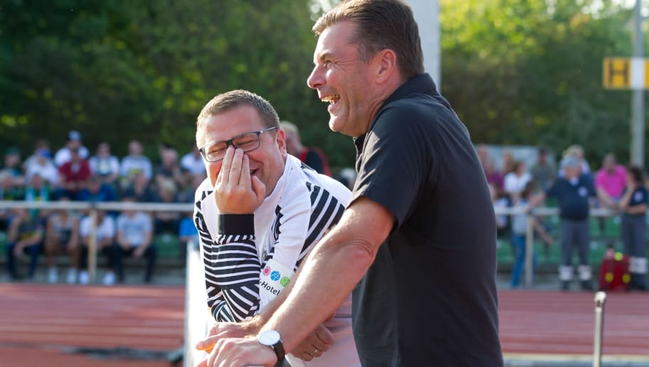 BREMEN, GERMANY - AUGUST 19: Max Eberl of Borussia Moenchengladbach and head coach Dieter Hecking of Borussia Moenchengladbach laugh prior to the DFB Cup first round match between BSC Hastedt and Borussia Moenchengladbach at Weserstadion Platz 11 on August 19, 2018 in Bremen, Germany. (Photo by TF-Images/Getty Images)
