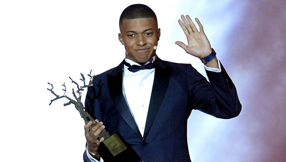 PARIS, FRANCE - DECEMBER 03:  Kylian Mbappe of France and Paris Saint-Germain wins the Kopa Trophy for best young player at the Ballon D'Or ceremony at Le Grand Palais on December 3, 2018 in Paris, France.  (Photo by Aurelien Meunier/Getty Images)