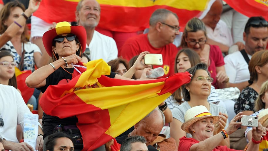 Spanish supporters wave Spanish flags during the opening ceremony of the XVIII Mediterranean Games in Tarragona, on June 22, 2018. (Photo by LLUIS GENE / AFP)        (Photo credit should read LLUIS GENE/AFP/Getty Images)