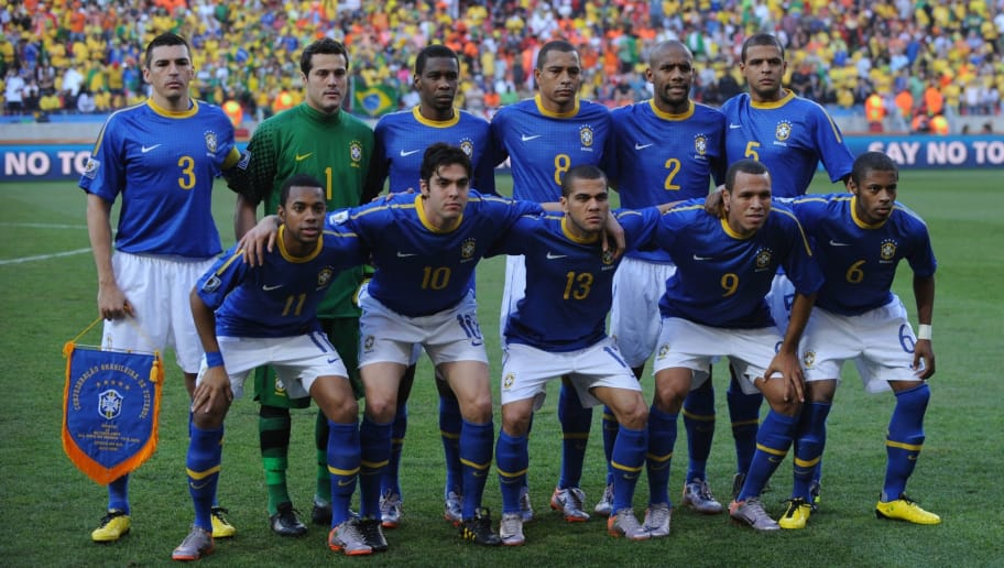 Members of Brazil's football team pose before the start of the 2010 World Cup quarter-final football match between the Netherlands and Brazil on July 2, 2010 at Nelson Mandela Bay stadium in Port Elizabeth. Pictured top row (L to R) are Brazil's defender Lucio, goalkeeper Julio Cesar, defender Juan, midfielder Gilberto Silva, defender Maicon, midfielder Felipe Melo and bottow rom (L to R) striker Robinho, midfielder Kaka, defender Daniel Alves, striker Luis Fabiano and defender Michel Bastos.                NO PUSH TO MOBILE / MOBILE USE SOLELY WITHIN EDITORIAL ARTICLE     AFP PHOTO / ANTONIO SCORZA (Photo credit should read ANTONIO SCORZA/AFP/Getty Images)
