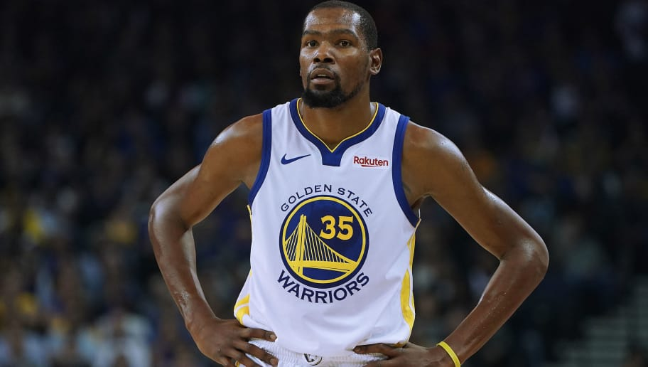 OAKLAND, CA - NOVEMBER 05:  Kevin Durant #35 of the Golden State Warriors looks on against the Memphis Grizzlies during an NBA basketball game at ORACLE Arena on November 5, 2018 in Oakland, California. NOTE TO USER: User expressly acknowledges and agrees that, by downloading and or using this photograph, User is consenting to the terms and conditions of the Getty Images License Agreement.  (Photo by Thearon W. Henderson/Getty Images)