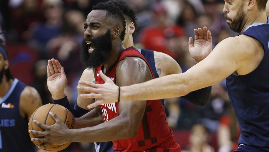 HOUSTON, TEXAS - DECEMBER 31: James Harden #13 of the Houston Rockets reacts after being double teamed by Marc Gasol #33 of the Memphis Grizzlies and Kyle Anderson #1 during the fourth quarter at Toyota Center on December 31, 2018 in Houston, Texas. NOTE TO USER: User expressly acknowledges and agrees that, by downloading and or using this photograph, User is consenting to the terms and conditions of the Getty Images License Agreement. (Photo by Bob Levey/Getty Images)