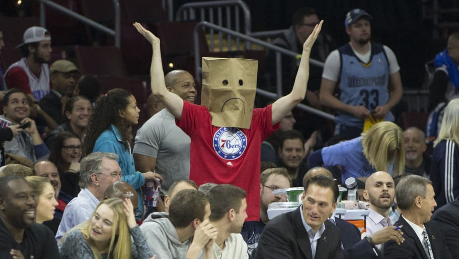 PHILADELPHIA, PA - DECEMBER 22: A Philadelphia 76ers fan looks on with a bag over his head during the game against the Memphis Grizzlies on December 22, 2015 at the Wells Fargo Center in Philadelphia, Pennsylvania. The Grizzles defeated the 76ers 104-90.  NOTE TO USER: User expressly acknowledges and agrees that, by downloading and or using this photograph, User is consenting to the terms and conditions of the Getty Images License Agreement. (Photo by Mitchell Leff/Getty Images)