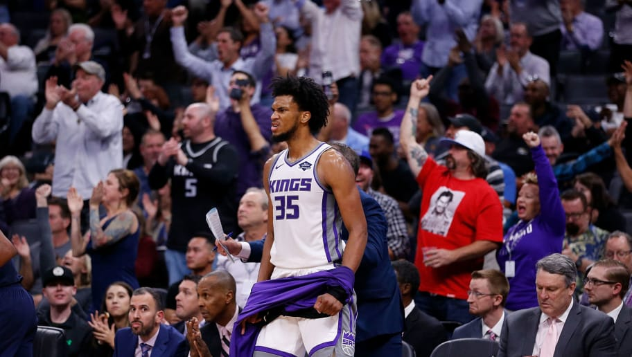 SACRAMENTO, CA - OCTOBER 24: Marvin Bagley III #35 of the Sacramento Kings reacts to a dunk by teammate De'Aaron Fox #5 at Golden 1 Center on October 24, 2018 in Sacramento, California. (Photo by Lachlan Cunningham/Getty Images)