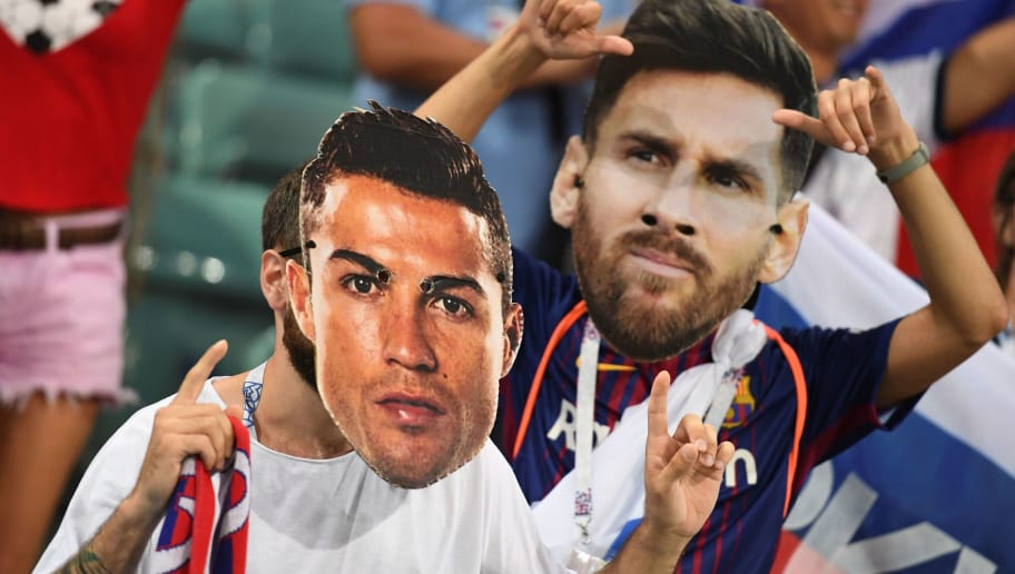 Football fans wearing masks depicting Portugal's forward Cristiano Ronaldo and Argentina's forward Lionel Messi pose before the Russia 2018 World Cup quarter-final football match between Russia and Croatia at the Fisht Stadium in Sochi on July 7, 2018. (Photo by Kirill KUDRYAVTSEV / AFP) / RESTRICTED TO EDITORIAL USE - NO MOBILE PUSH ALERTS/DOWNLOADS        (Photo credit should read KIRILL KUDRYAVTSEV/AFP/Getty Images)