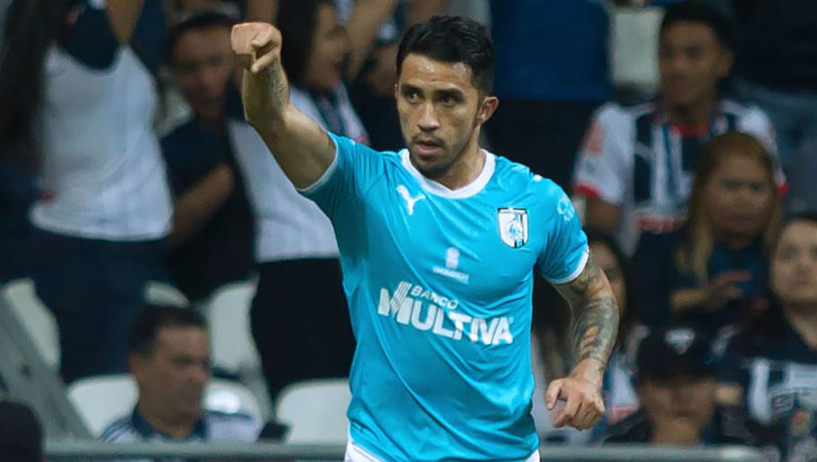 Chilean Edson Puch of Queretaro celebrates after scoring against Monterrey during their Mexican Apertura football tournament match at the BBVA Bancomer stadium in Monterrey, Mexico, on August 4, 2018. (Photo by Julio Cesar AGUILAR / AFP)        (Photo credit should read JULIO CESAR AGUILAR/AFP/Getty Images)