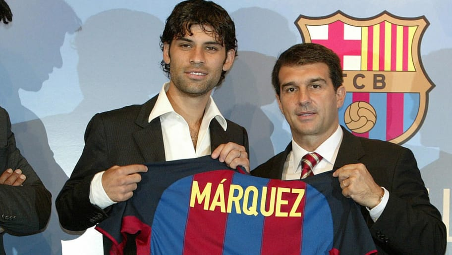 Mexican defender Rafael Marquez (C) poses with FC Barcelona's President Joan Laporta (R) and FC Barcelona's coach Franck Rijkaard (L)  during his official presentation as a Barcelona player, 09 July 2003. Marquez, 24-year-old, who played in French first division team Monaco since 1999, is to sign a four-year contract with FC Barcelona. AFP PHOTO   (Photo credit should read LLUIS GENE/AFP/Getty Images)