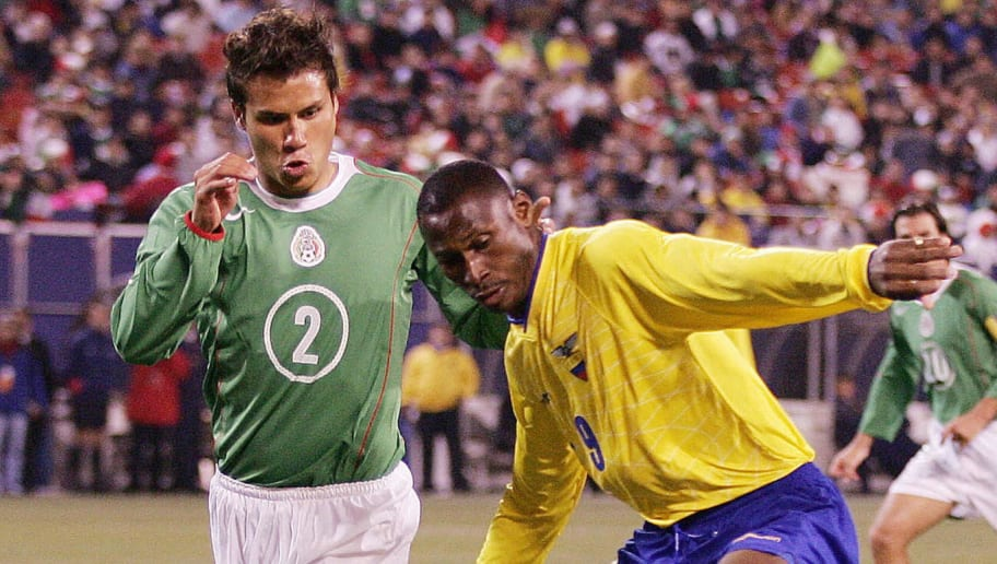 Mexico's Aaron Galindo (L) puts the pres