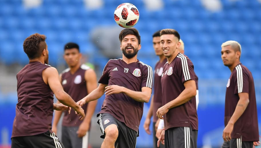SAMARA, RUSSIA - JULY 01: Jonathan dos Santos, Oribe Peralta, Hector Herrera and Jesus Manuel Corona of Mexico, in action during a training at Samara Arena ahead of the Round of Sixteen match against Brazil on July 1, 2018 in Samara, Russia. (Photo by Hector Vivas/Getty Images)
