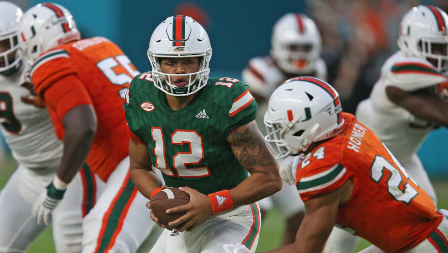MIAMI GARDENS, FL - APRIL 14: Malik Rosier #12 fakes the handoff to Travis Homer #24 of the Miami Hurricanes during the spring game on April 14, 2017 at Hard Rock Stadium in Miami Gardens, Florida. (Photo by Joel Auerbach/Getty Images)
