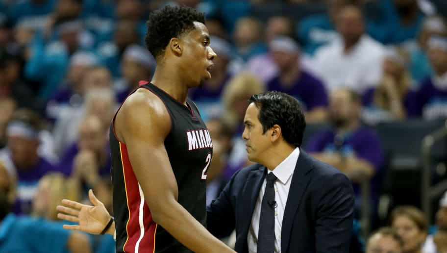 CHARLOTTE, NC - APRIL 25:  Head coach Erik Spoelstra stands with his player Hassan Whiteside #21 of the Miami Heat against the Charlotte Hornets during game four of the Eastern Conference Quarterfinals of the 2016 NBA Playoffs at Time Warner Cable Arena on April 25, 2016 in Charlotte, North Carolina.  NOTE TO USER: User expressly acknowledges and agrees that, by downloading and or using this photograph, User is consenting to the terms and conditions of the Getty Images License Agreement.  (Photo by Streeter Lecka/Getty Images)