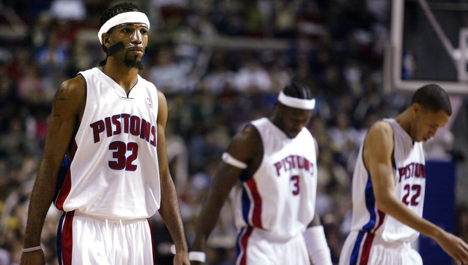 AUBURN HILLS, MI - DECEMBER 30:  Richard Hamilton #32, Ben Wallace #3 and Tayshaun Prince #22 of the Detroit Pistons look on during a break in play late in the game against the Miami Heat at The Palace of Auburn Hills on December 30, 2004 in Auburn Hills, Michigan. The Heat won the game, 89-78.  NOTE TO USER:  User expressly acknowledges and agrees that, by downloading and/or using this Photograph, user is consenting to the terms and conditions of the Getty Images License Agreement.  (Photo by Tom Pidgeon/Getty Images)