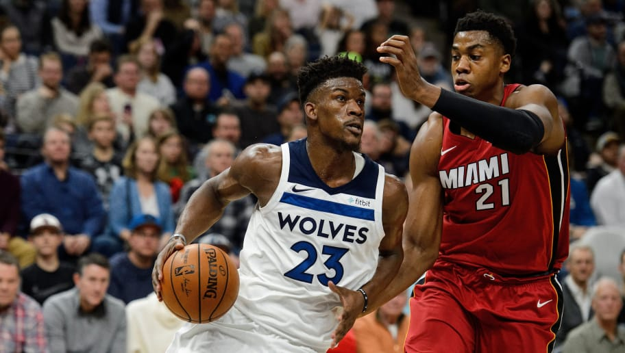 MINNEAPOLIS, MN - NOVEMBER 24: Jimmy Butler #23 of the Minnesota Timberwolves drives to the basket against Hassan Whiteside #21 of the Miami Heat during the game on November 24, 2017 at the Target Center in Minneapolis, Minnesota. NOTE TO USER: User expressly acknowledges and agrees that, by downloading and or using this Photograph, user is consenting to the terms and conditions of the Getty Images License Agreement. (Photo by Hannah Foslien/Getty Images)