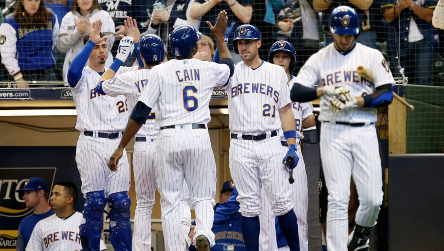 MILWAUKEE, WI - APRIL 22:  Christian Yelich #22 and Lorenzo Cain #6 of the Milwaukee Brewers celebrate with teammates after Yelich hit a home run in the fourth inning against the Miami Marlins at Miller Park on April 22, 2018 in Milwaukee, Wisconsin. (Photo by Dylan Buell/Getty Images)