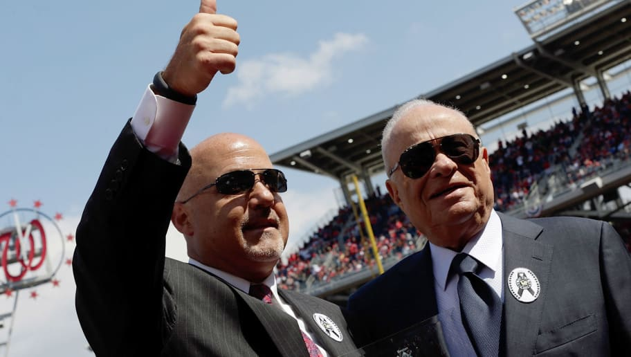 WASHINGTON, DC - APRIL 01:  Washington Nationals General Manager Mike Rizzo (L) gives a thumbs up to the crowd with Nationals owner Ted Lerner while accepting an award for MLB Executive of the Year before the Opening Day game against the Miami Marlins at Nationals Park on Monday, April 1, 2013 in Washington, DC.  (Photo by Win McNamee/Getty Images)