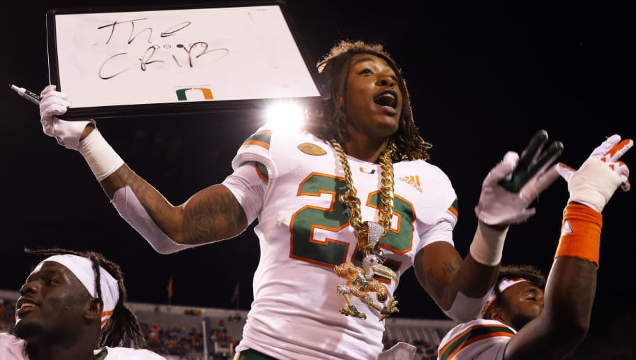 CHARLOTTESVILLE, VA - OCTOBER 13: Sheldrick Redwine #22 of the Miami Hurricanes celebrates with the turnover chain in the first half during a game against the Virginia Cavaliers at Scott Stadium on October 13, 2018 in Charlottesville, Virginia. (Photo by Ryan M. Kelly/Getty Images)