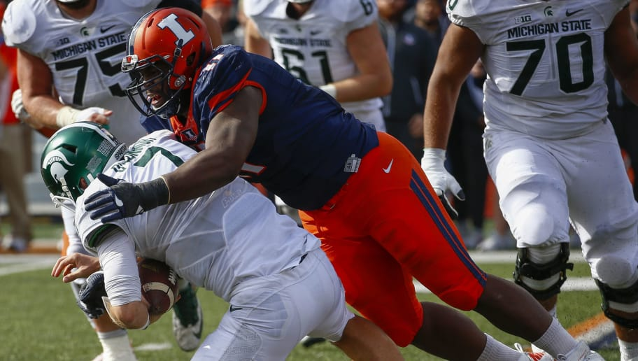 CHAMPAIGN, IL - NOVEMBER 05: Chunky Clements #11 of the Illinois Fighting Illini makes the sack on Tyler O'Connor #7 of the Michigan State Spartans at Memorial Stadium on November 5, 2016 in Champaign, Illinois. Illinois defeated Michigan State 31-27. (Photo by Michael Hickey/Getty Images)