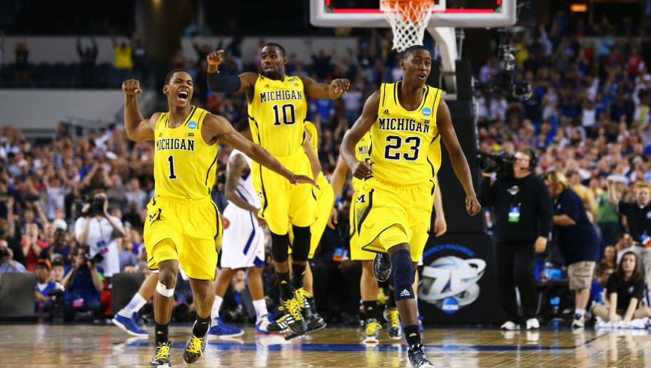 ARLINGTON, TX - MARCH 29:  Glenn Robinson III #1, Tim Hardaway Jr. #10 and Caris LeVert #23 of the Michigan Wolverines celebrate their 87 to 85 win over the Kansas Jayhawks in overtime during the South Regional Semifinal round of the 2013 NCAA Men's Basketball Tournament at Dallas Cowboys Stadium on March 29, 2013 in Arlington, Texas.  (Photo by Tom Pennington/Getty Images)