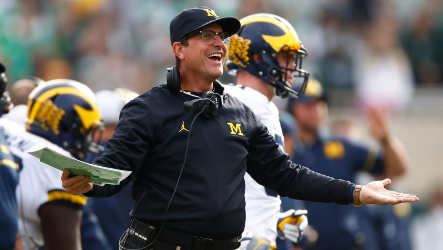 EAST LANSING, MI - OCTOBER 29: Head coach Jim Harbaugh reacts on the sidelines while playing the Michigan State Spartans at Spartan Stadium on October 29, 2016 in East Lansing, Michigan. Michigan won the game 32-23. (Photo by Gregory Shamus/Getty Images)