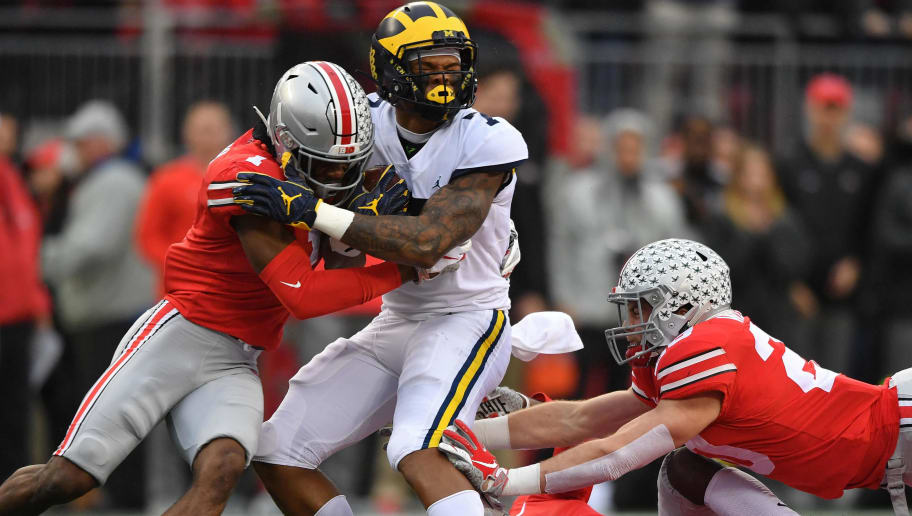 COLUMBUS, OH - NOVEMBER 24:  Jeffrey Okudah #1 of the Ohio State Buckeyes hits Tarik Black #7 of the Michigan Wolverines in the first quarter after a gain at Ohio Stadium on November 24, 2018 in Columbus, Ohio.  (Photo by Jamie Sabau/Getty Images)