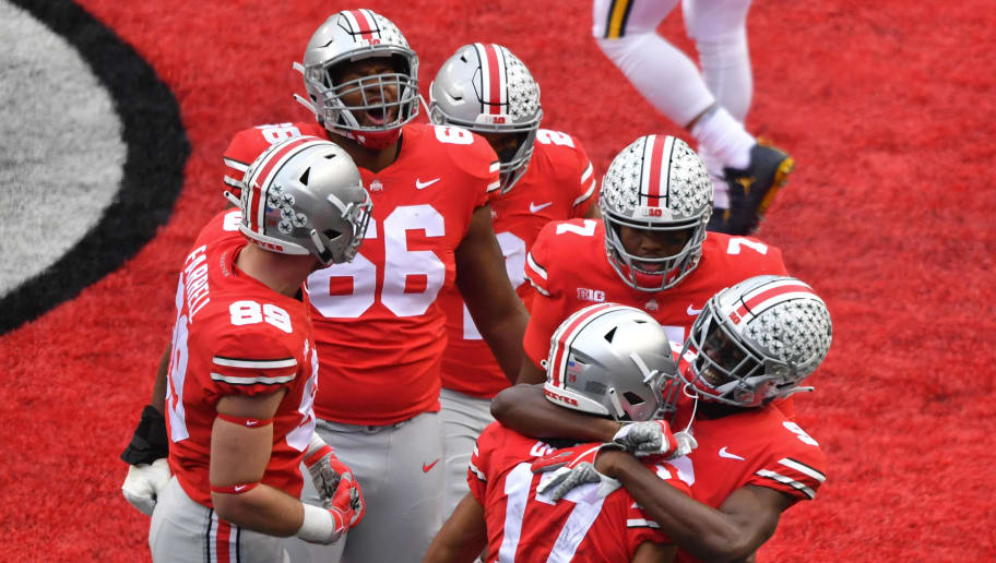 COLUMBUS, OH - NOVEMBER 24:  The Ohio State Buckeyes celebrate with Chris Olave #17 of the Ohio State Buckeyes after a first quarter touchdown against the Michigan Wolverines at Ohio Stadium on November 24, 2018 in Columbus, Ohio.  (Photo by Jamie Sabau/Getty Images)