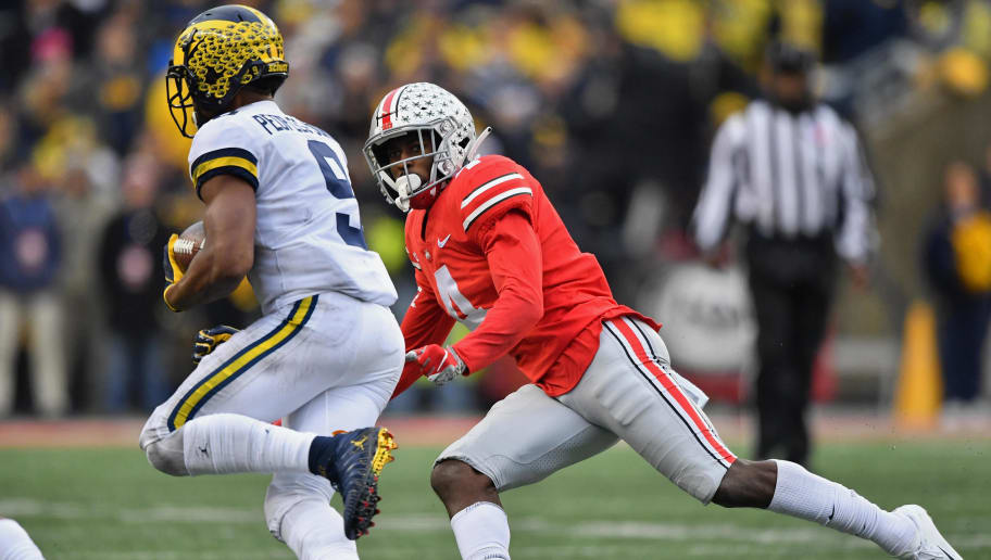 COLUMBUS, OH - NOVEMBER 24:  Jordan Fuller #4 of the Ohio State Buckeyes defends against the Michigan Wolverines at Ohio Stadium on November 24, 2018 in Columbus, Ohio. Ohio State defeated Michigan 62-39.  (Photo by Jamie Sabau/Getty Images)