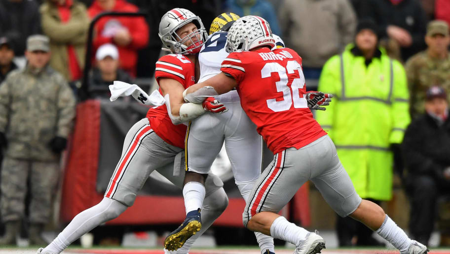 COLUMBUS, OH - NOVEMBER 24:  Pete Werner #20 of the Ohio State Buckeyes and Tuf Borland #32 of the Ohio State Buckeyes team up to tackle a Michigan Wolverine ballcarrier at Ohio Stadium on November 24, 2018 in Columbus, Ohio. Ohio State defeated Michigan 62-39.  (Photo by Jamie Sabau/Getty Images)