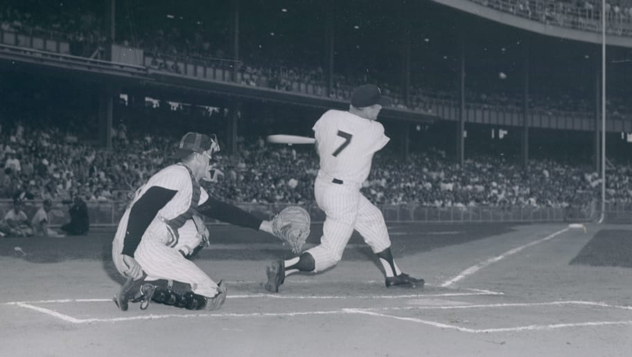UNSPECIFIED - UNDATED: Mickey Mantle batting during a night game at Yankee Stadium in this undated photo. (Photo by Sports Studio Photos/Getty Images)