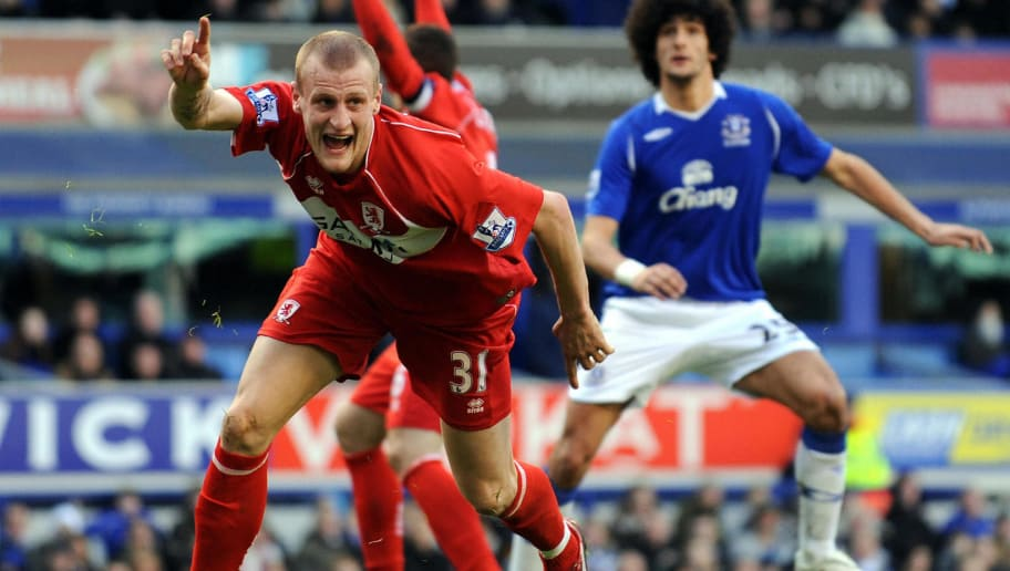 Middlesbrough's English midfielder David Wheater (L) celebrates after scoring the opening goal during the FA cup Quarter final football match against Everton at Goodison Park, Liverpool, north-west England on March 8, 2009. AFP PHOTO/ANDREW YATES FOR EDITORIAL USE ONLY Additional licence required for any commercial/promotional use or use on TV or internet (except identical online version of newspaper) of Premier League/Football League photos. Tel DataCo +44 207 2981656. Do not alter/modify photo (Photo credit should read ANDREW YATES/AFP/Getty Images)