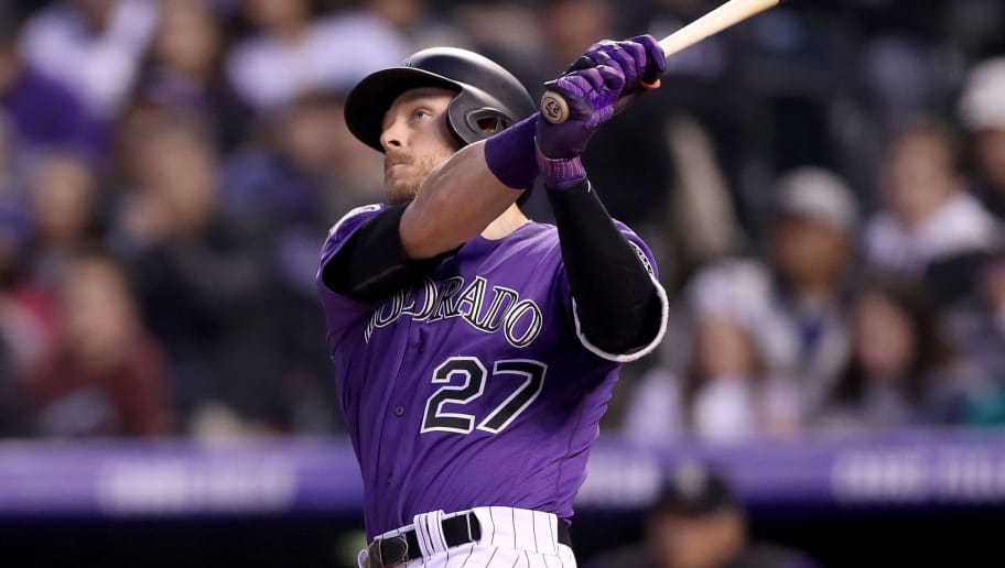 DENVER, CO - MAY 12:  Trevor Story #27 of the Colorado Rockies ihits a solo home run in the fifth inning against the Milwaukee Brewers at Coors Field on May 12, 2018 in Denver, Colorado.  (Photo by Matthew Stockman/Getty Images)