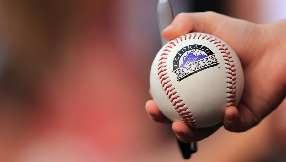 DENVER, CO - JULY 27:  A young fan holds a baseball hoping to get an autograph as the Milwaukee Brewers face the Colorado Rockies at Coors Field on July 27, 2013 in Denver, Colorado.  (Photo by Doug Pensinger/Getty Images)