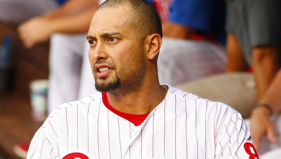 PHILADELPHIA, PA - JULY 23: Shane Victorino #8 of the Philadelphia Phillies reacts after he was hit by a pitch on the forearm on a swinging third strike as called by home plate umpire Tom Hallion #20 in the first inning against the Milwaukee Brewers  during a MLB baseball game on July 23, 2012 at Citizens Bank Park in Philadelphia, Pennsylvania. (Photo by Rich Schultz/Getty Images)