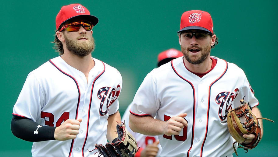 WASHINGTON, DC - JULY 27:  Bryce Harper #34 and Daniel Murphy #20 of the Washington Nationals run to the dugout during the game against the Milwaukee Brewers at Nationals Park on July 27, 2017 in Washington, DC.  (Photo by G Fiume/Getty Images)