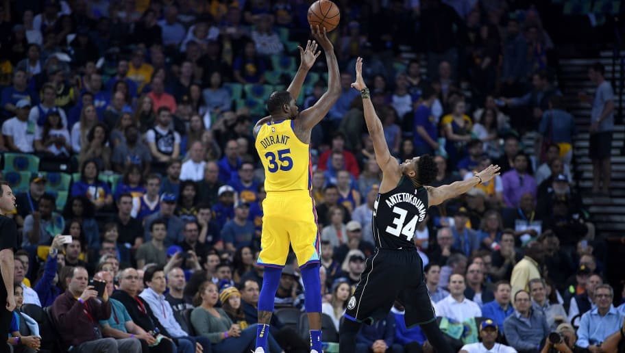 OAKLAND, CA - MARCH 29:  Kevin Durant #35 of the Golden State Warriors shoots over Giannis Antetokounmpo #34 of the Milwaukee Bucks during an NBA basketball game at ORACLE Arena on March 29, 2018 in Oakland, California. NOTE TO USER: User expressly acknowledges and agrees that, by downloading and or using this photograph, User is consenting to the terms and conditions of the Getty Images License Agreement.  (Photo by Thearon W. Henderson/Getty Images)