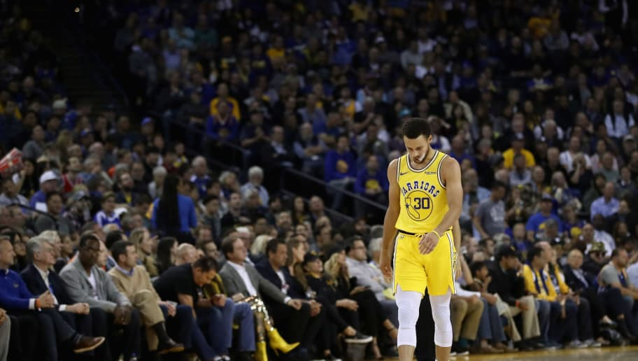 OAKLAND, CA - NOVEMBER 08:  Stephen Curry #30 of the Golden State Warriors walks back downcourt during their loss to the Milwaukee Bucks at ORACLE Arena on November 8, 2018 in Oakland, California.  NOTE TO USER: User expressly acknowledges and agrees that, by downloading and or using this photograph, User is consenting to the terms and conditions of the Getty Images License Agreement.  (Photo by Ezra Shaw/Getty Images)