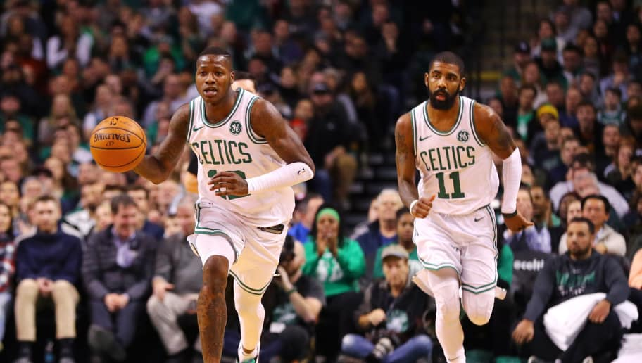 BOSTON, MA - JANUARY 4: Terry Rozier #12 of the Boston Celtics and Kyrie Irving #11 make their way down court during the second half against the Minnesota Timberwolves at TD Garden on January 5, 2018 in Boston, Massachusetts. The Celtics defeat the Timberwolves 91-84. (Photo by Maddie Meyer/Getty Images)