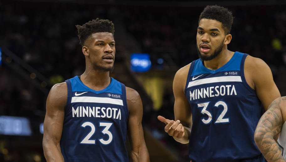 CLEVELAND, OH - FEBRUARY 7: Jimmy Butler #23 talks with Karl-Anthony Towns #32 of the Minnesota Timberwolves during the first half against the Cleveland Cavaliers at Quicken Loans Arena on February 7, 2018 in Cleveland, Ohio. NOTE TO USER: User expressly acknowledges and agrees that, by downloading and or using this photograph, User is consenting to the terms and conditions of the Getty Images License Agreement. (Photo by Jason Miller/Getty Images)