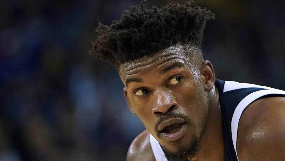 OAKLAND, CA - NOVEMBER 02:  Jimmy Butler #23 of the Minnesota Timberwolves looks on against the Golden State Warriors during an NBA basketball game at ORACLE Arena on November 2, 2018 in Oakland, California. NOTE TO USER: User expressly acknowledges and agrees that, by downloading and or using this photograph, User is consenting to the terms and conditions of the Getty Images License Agreement.  (Photo by Thearon W. Henderson/Getty Images)