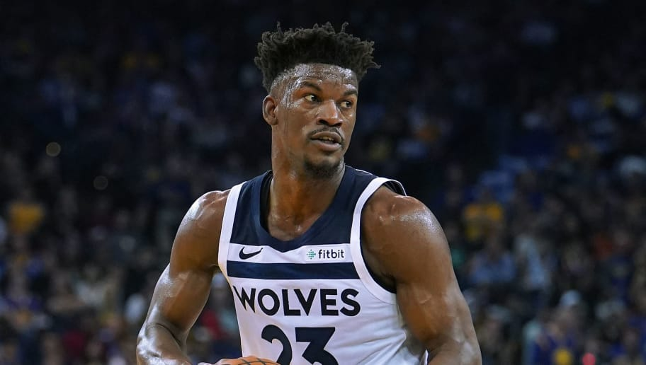 OAKLAND, CA - NOVEMBER 02:  Jimmy Butler #23 of the Minnesota Timberwolves looks to pass the ball against the Golden State Warriors during an NBA basketball game at ORACLE Arena on November 2, 2018 in Oakland, California. NOTE TO USER: User expressly acknowledges and agrees that, by downloading and or using this photograph, User is consenting to the terms and conditions of the Getty Images License Agreement.  (Photo by Thearon W. Henderson/Getty Images)