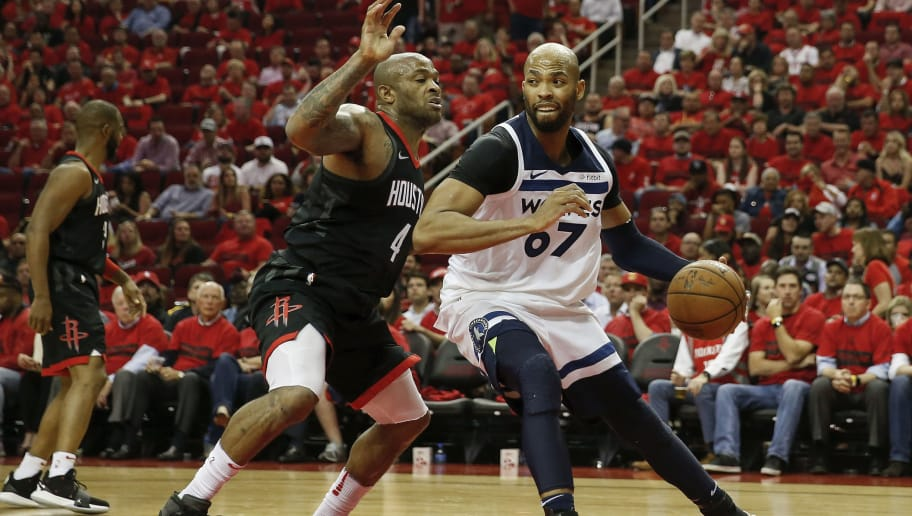 HOUSTON, TX - APRIL 25:  Taj Gibson #67 of the Minnesota Timberwolves drives to the basket defended by PJ Tucker #4 of the Houston Rockets in the second half during Game Five of the first round of the 2018 NBA Playoffs at Toyota Center on April 25, 2018 in Houston, Texas.  NOTE TO USER: User expressly acknowledges and agrees that, by downloading and or using this photograph, User is consenting to the terms and conditions of the Getty Images License Agreement.  (Photo by Tim Warner/Getty Images)